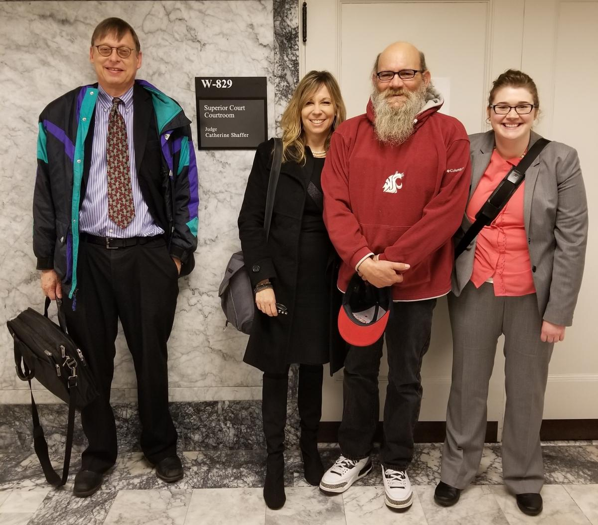 Left to Right: Jim Lobsenz of Carney Badley Spellman, Ann LoGerfo of Columbia Legal Services, Steven Long, and Alison Bilow of Columbia Legal Services.