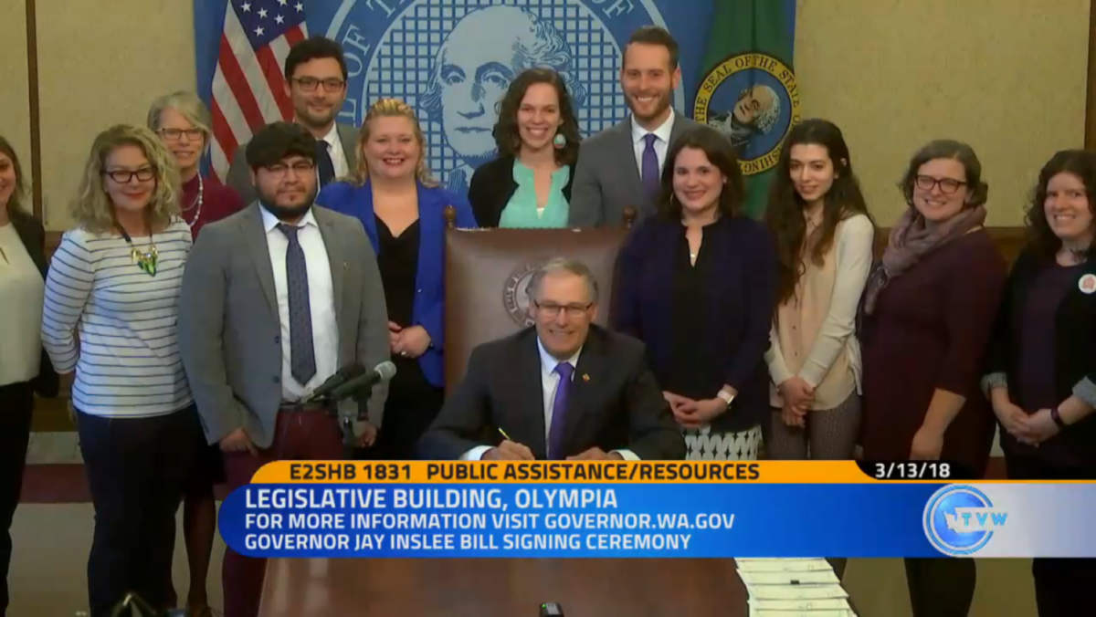 Washington Gov. Jay Inslee signs into law a bill that promotes self-sufficiency and savings by raising long outdated asset limits for safety net programs in March 2018.